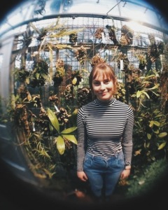 Betty had an awesome attachment for her phone camera that distorted the picture - so naturally, here is a picture of me in front of some plants.